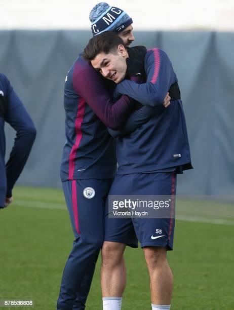 Bernardo Silva hugs Brahim Diaz during training at Manchester City Football Academy on November 24 2017 in Manchester England