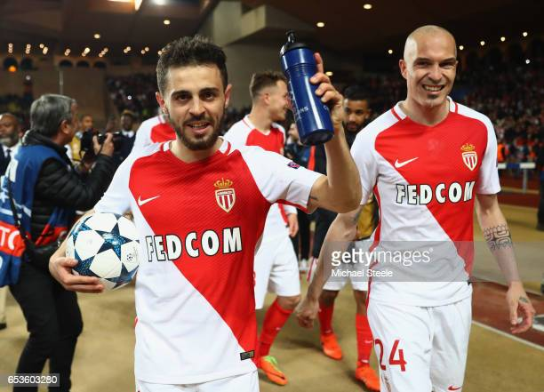 Bernardo Silva of AS Monaco celebrates victory with team mate Andrea Raggi after the UEFA Champions League Round of 16 second leg match between AS...