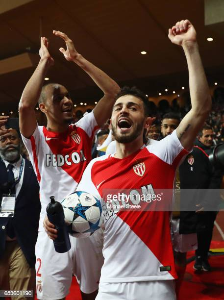 Bernardo Silva of AS Monaco celebrates victory with team mate Fabinho after the UEFA Champions League Round of 16 second leg match between AS Monaco...