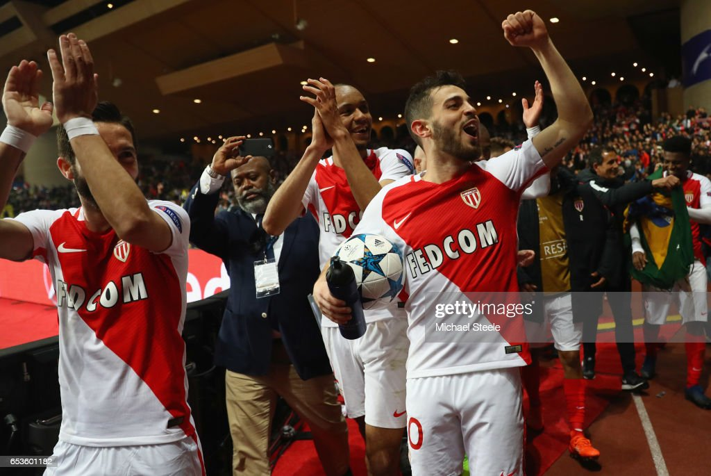 Bernardo Silva of AS Monaco (with ball) celebrates victory with team mates Joao Moutinho and Fabinho after the UEFA Champions League Round of 16 second leg match between AS Monaco and Manchester City FC at Stade Louis II on March 15, 2017 in Monaco, Monaco. Monaco won by 3 goals to 1 and progress to the quarter finals on the away goals rule.
