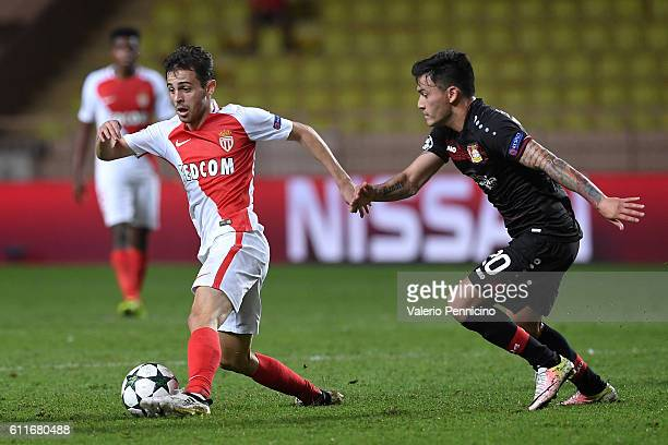 Bernardo Silva of AS Monaco FC is challenged by Charles Aranguiz of Bayer 04 Leverkusen during the UEFA Champions League Group E match between AS...