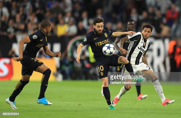 Bernardo Silva of AS Monaco holds off Dani Alves of Juventus during the UEFA Champions League Semi Final second leg match between Juventus and AS...