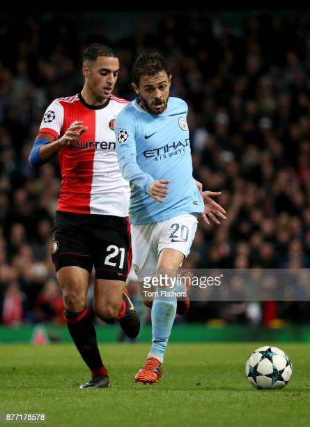 Bernardo Silva of Manchester City and Sofyan Amrabat of Feyenoord battle for possession during the UEFA Champions League group F match between...