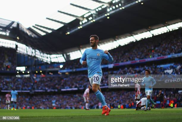 Bernardo Silva of Manchester City celebrates scoring his sides seventh goal during the Premier League match between Manchester City and Stoke City at...