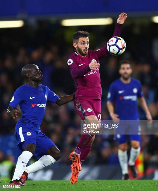 Bernardo Silva of Manchester City controls the ball while under pressure from N'Golo Kante of Chelsea during the Premier League match between Chelsea...