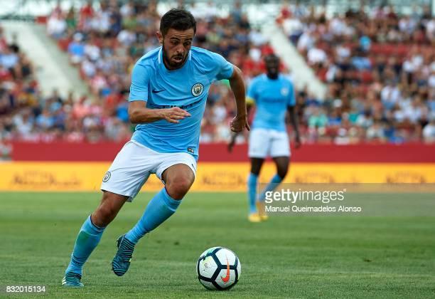 Bernardo Silva of Manchester City runs with the ball during the preseason friendly match between Girona and Manchester City at Municipal de Montilivi...
