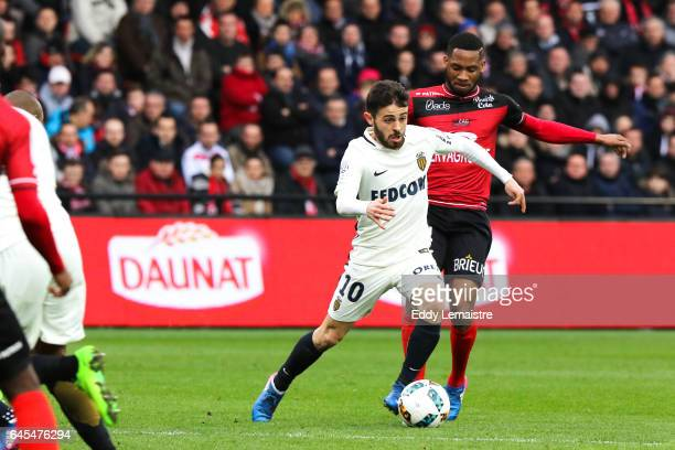 Bernardo Silva of Monaco and Marcus Coco of Guingamp during the French Ligue 1 match between Guingamp and Monaco at Stade du Roudourou on February 25...