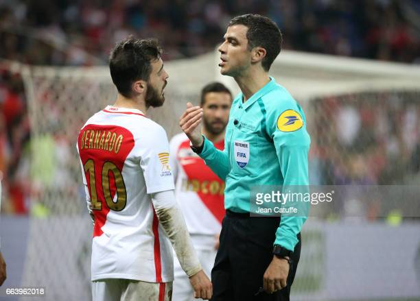 Bernardo Silva of Monaco argues with referee Frank Schneider during the French League Cup final between Paris SaintGermain and AS Monaco at Parc OL...