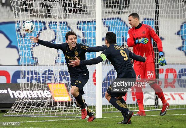 Bernardo Silva of Monaco celebrates his second goal with Radamel Falcao while goalkeeper of Marseille Yohann Pele looks dejected during the French...