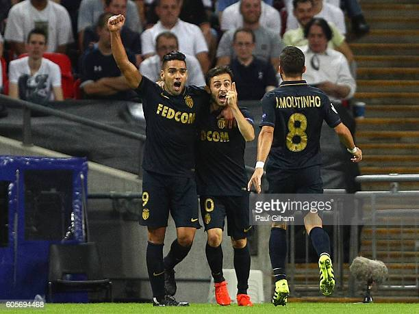 Bernardo Silva of Monaco celebrates with Radamel Falcao Garcia and Joao Moutinho as he scores their first goal during the UEFA Champions League match...