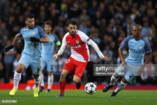Bernardo Silva of Monaco competes with Fernandinho and Sergio Aguero of Manchester City during the UEFA Champions League Round of 16 first leg match...