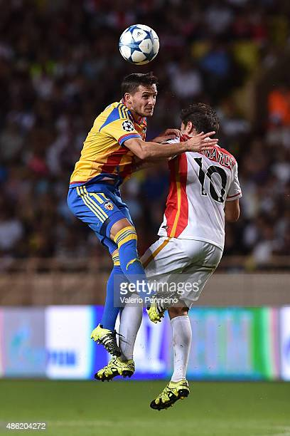 Bernardo Silva of Monaco goes up with Pablo Piatti of Valencia during the UEFA Champions League qualifying round play off second leg match between...