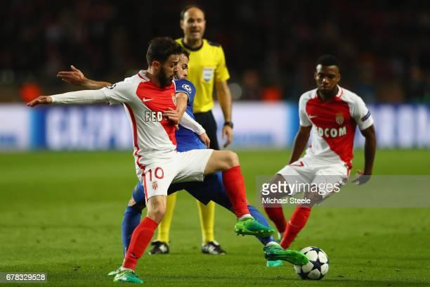 Bernardo Silva of Monaco is challenged by Miralem Pjanic of Juventus during the UEFA Champions League Semi Final first leg match between AS Monaco v...
