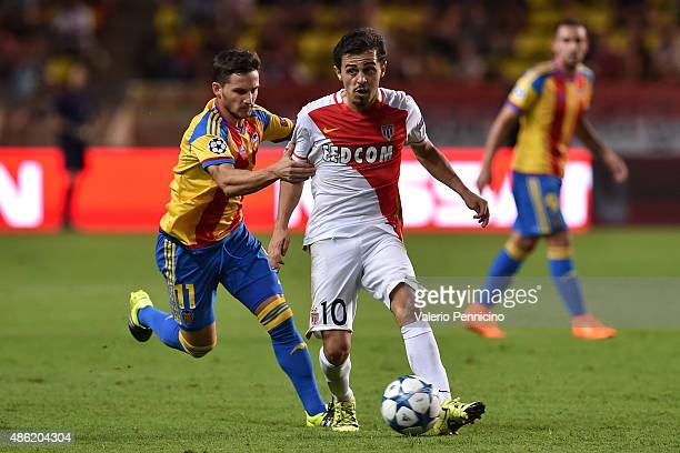 Bernardo Silva of Monaco is challenged by Pablo Piatti of Valencia during the UEFA Champions League qualifying round play off second leg match...