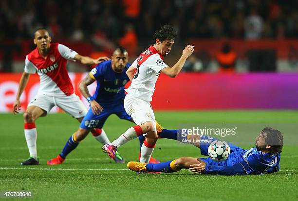 Bernardo Silva of Monaco is tackled by Andrea Pirlo of Juventus during the UEFA Champions League quarterfinal second leg match between AS Monaco FC...
