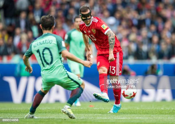 Bernardo Silva of Portugal and Fedor Kudryashov of Russia fight for the ball during the FIFA Confederations Cup Russia 2017 Group A match between...