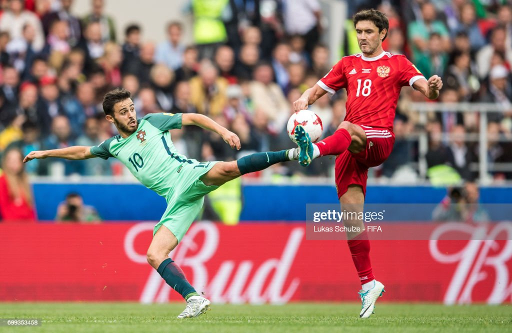 Bernardo Silva (L) of Portugal and Yuri Zhirkov (R) of Russia fight for the ball during the FIFA Confederations Cup Russia 2017 Group A match between Russia and Portugal at Spartak Stadium on June 21, 2017 in Moscow, Russia.