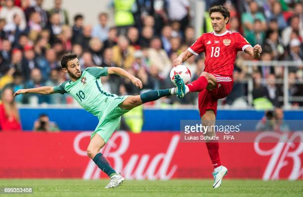 Bernardo Silva of Portugal and Yuri Zhirkov of Russia fight for the ball during the FIFA Confederations Cup Russia 2017 Group A match between Russia...