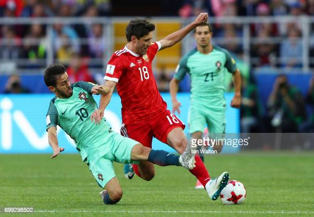 Bernardo Silva of Portugal and Yury Zhirkov of Russia battle for possession during the FIFA Confederations Cup Russia 2017 Group A match between...