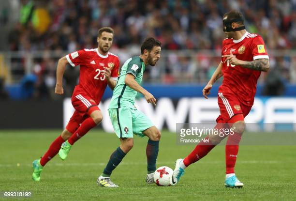 Bernardo Silva of Portugal attempts to take the ball past Fedor Kudriashov of Russia during the FIFA Confederations Cup Russia 2017 Group A match...