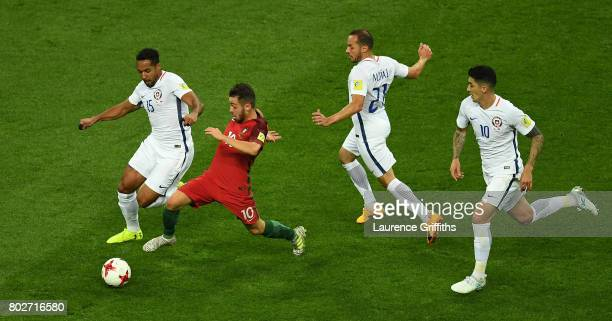 Bernardo Silva of Portugal competes for the ball against Jean Beausejour Marcelo Diaz and Pablo Hernandez of Chile during the FIFA Confederations Cup...