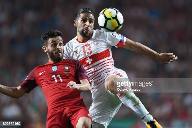 Bernardo Silva of Portugal competes for the ball with Ricardo Rodriguez of Switzerland during the FIFA 2018 World Cup Qualifier between Portugal and...