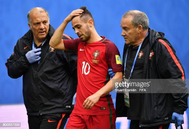 Bernardo Silva of Portugal receives treatment from the medical team during the FIFA Confederations Cup Russia 2017 Group A match between New Zealand...