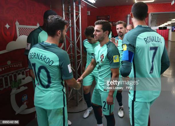 Bernardo Silva of Portugal speaks to Cedric of Portugal in the tunnel during the FIFA Confederations Cup Russia 2017 Group A match between Russia and...