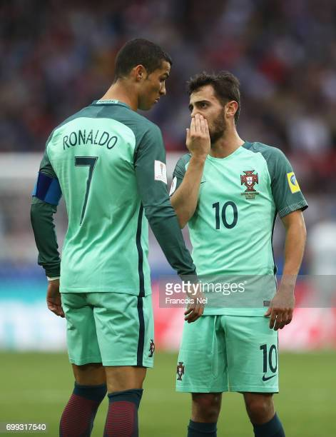 Bernardo Silva of Portugal speaks to Cristiano Ronaldo of Portugal during the FIFA Confederations Cup Russia 2017 Group A match between Russia and...