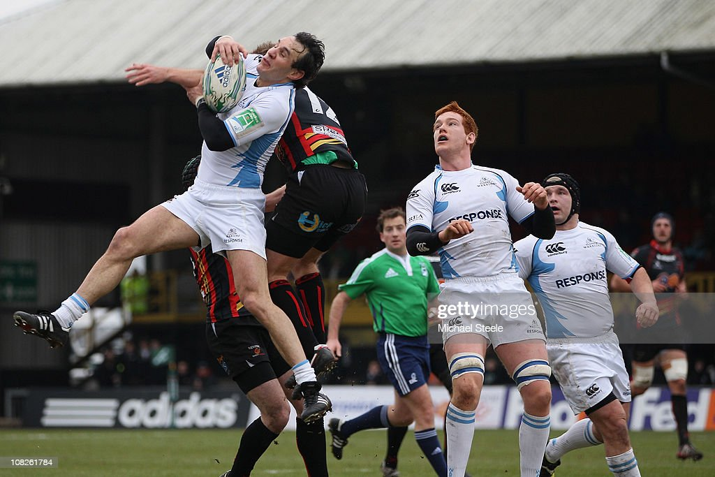 Bernardo Stortoni of Glasgow wins the ball from Ashley Smith during the Heineken Cup Round Six match between Newport Gwent Dragons and Glasgow...