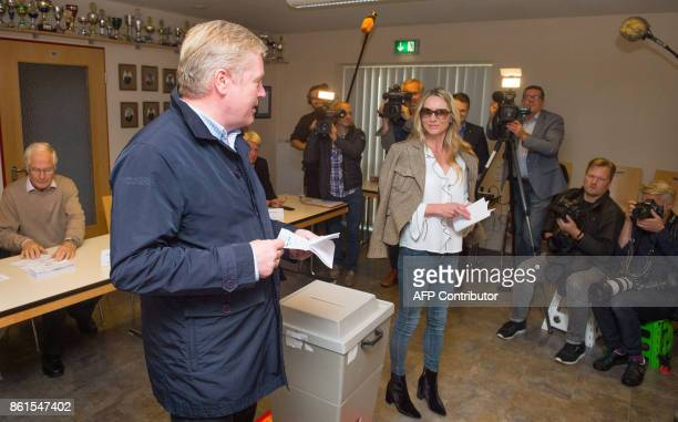 Bernd Althusmann top candidate of the conservative Christian Democratic Union party for regional elections in Lower Saxony and his wife Iris cast...