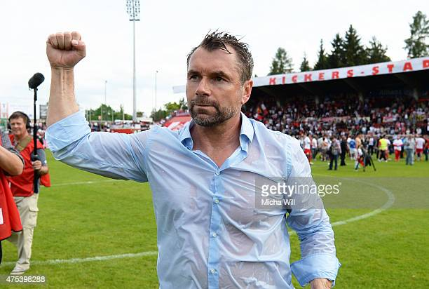 Bernd Hollerbach head coach of Wuerzburg celebrates his teams promotion to the third league with the fans after the Regionalliga Playoffs match...