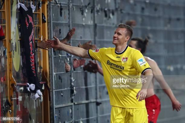 Bernd Leno and Julian Baumgartlinger of Leverkusen celebrate with the fans after the Bundesliga match between SV Darmstadt 98 and Bayer 04 Leverkusen...