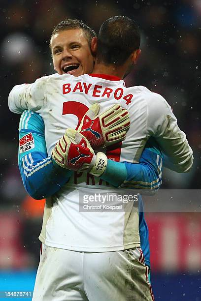 Bernd Leno and Oemer Toplak of Leverkusen celebrate the 21 victory after the Bundesliga match between FC Bayern Muenchen and Bayer 04 Leverkusen at...