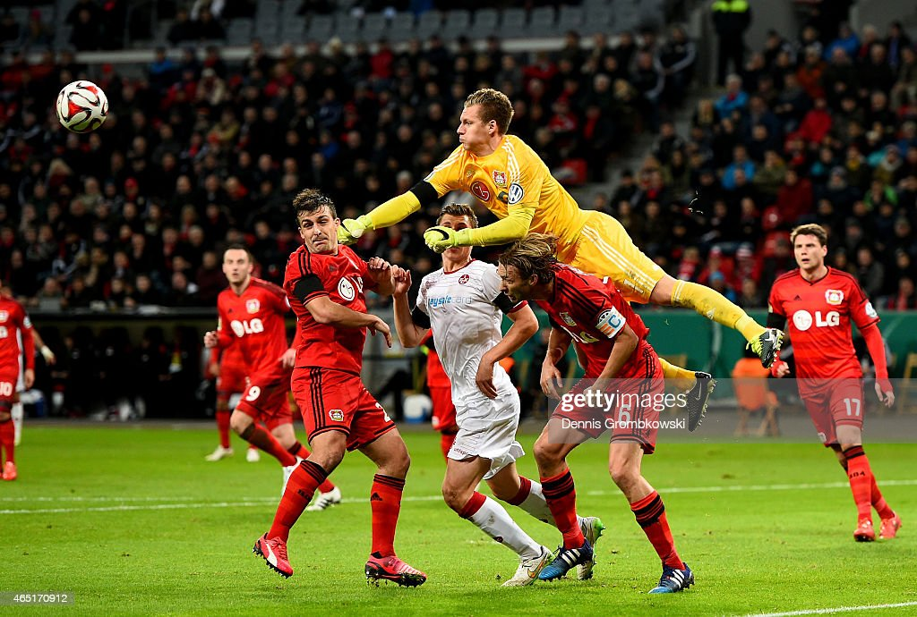 <a gi-track='captionPersonalityLinkClicked' href=/galleries/search?phrase=Bernd+Leno&family=editorial&specificpeople=5528639 ng-click='$event.stopPropagation()'>Bernd Leno</a> (C), goalkeeper of Leverkusen makes a save during the round of 16 DFB Cup match between Bayer 04 Leverkusen and 1. FC Kaiserlautern at BayArena on March 3, 2015 in Leverkusen, Germany.