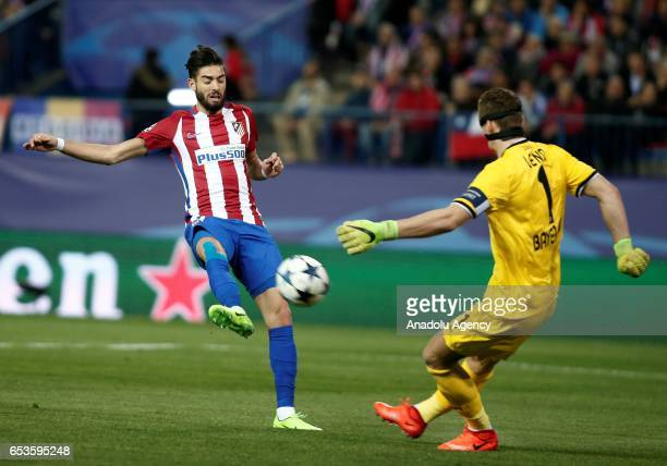 Bernd Leno of Bayer 04 Leverkusen in action against Yannick Carrasco of Atletico Madrid during the UEFA Champions League Round of 16 football match...