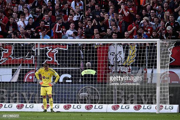 Bernd Leno of Bayer Leverkusen looks dejected after scoring an own goal during the Bundesliga match between Bayer Leverkusen and FC Augsburg at...