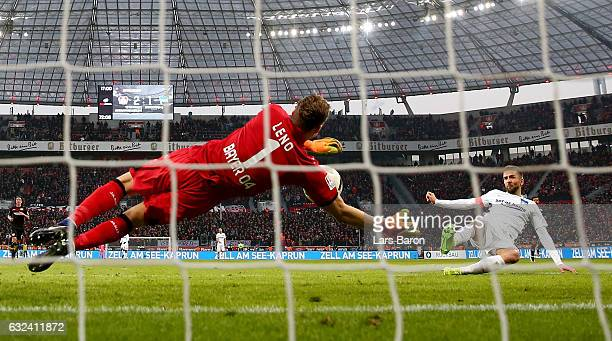 Bernd Leno of Bayer Leverkusen saves a shot of Vedad Ibisevic of Berlin during the Bundesliga match between Bayer 04 Leverkusen and Hertha BSC at...