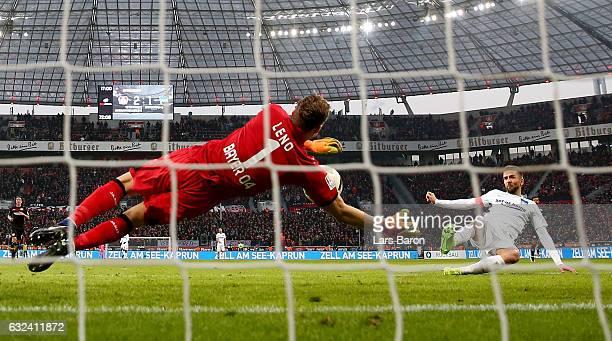 Bernd Leno of Bayer Leverkusen saves a shot of Vedad Ibisevic of Berlin during the Bundesliga match between Bayer 04 Leverkusen and Hertha BSC at...