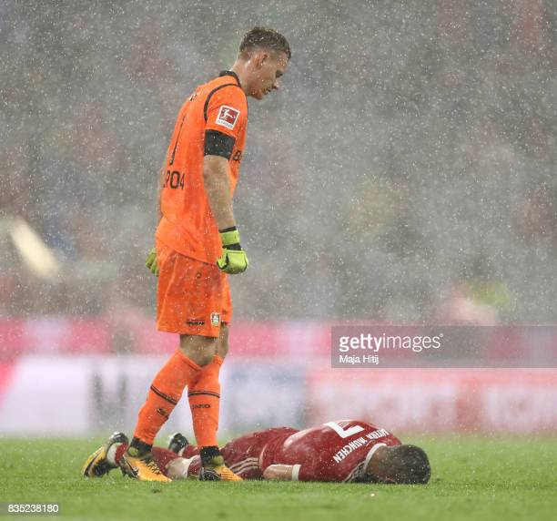 Bernd Leno of Bayer Leverkusen stand over Franck Ribery of Bayern Muenchen during the Bundesliga match between FC Bayern Muenchen and Bayer 04...