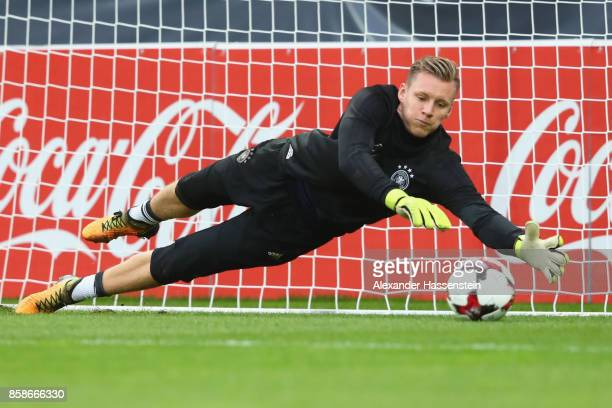 Bernd Leno of Germany safes tha ball during a training session at Opel Arena Mainz ahead of their FIFA 2018 World Cup Group C against Azerbaijan on...