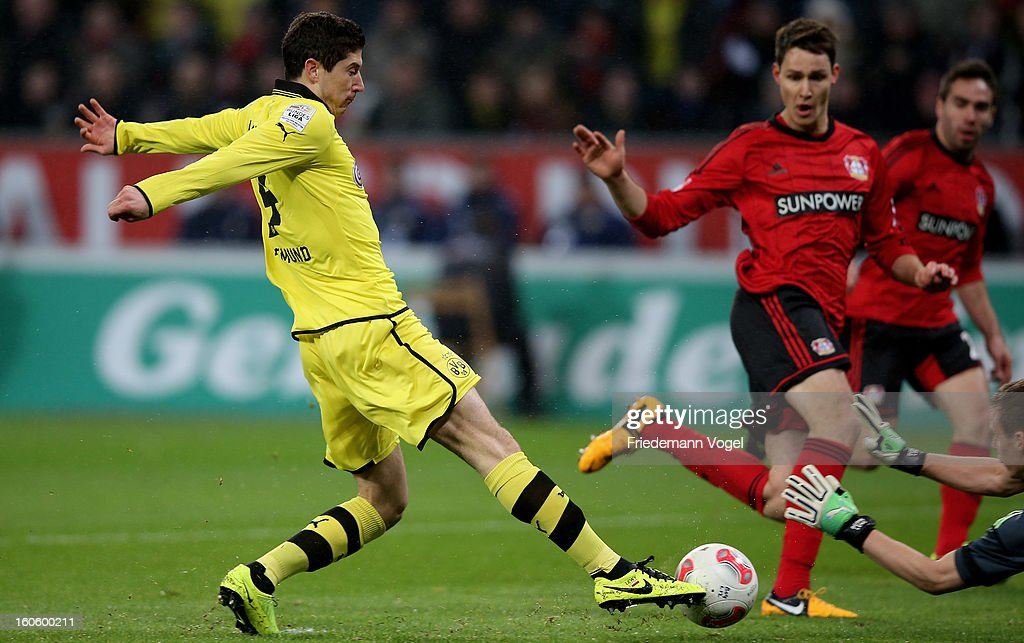 Bernd Leno (R) of Leverkusen and Robert Lewandowski (L) of Dortmund battle for the ball during the Bundesliga match between Bayer 04 Leverkusen and Borussia Dortmund at BayArena on February 3, 2013 in Leverkusen, Germany.