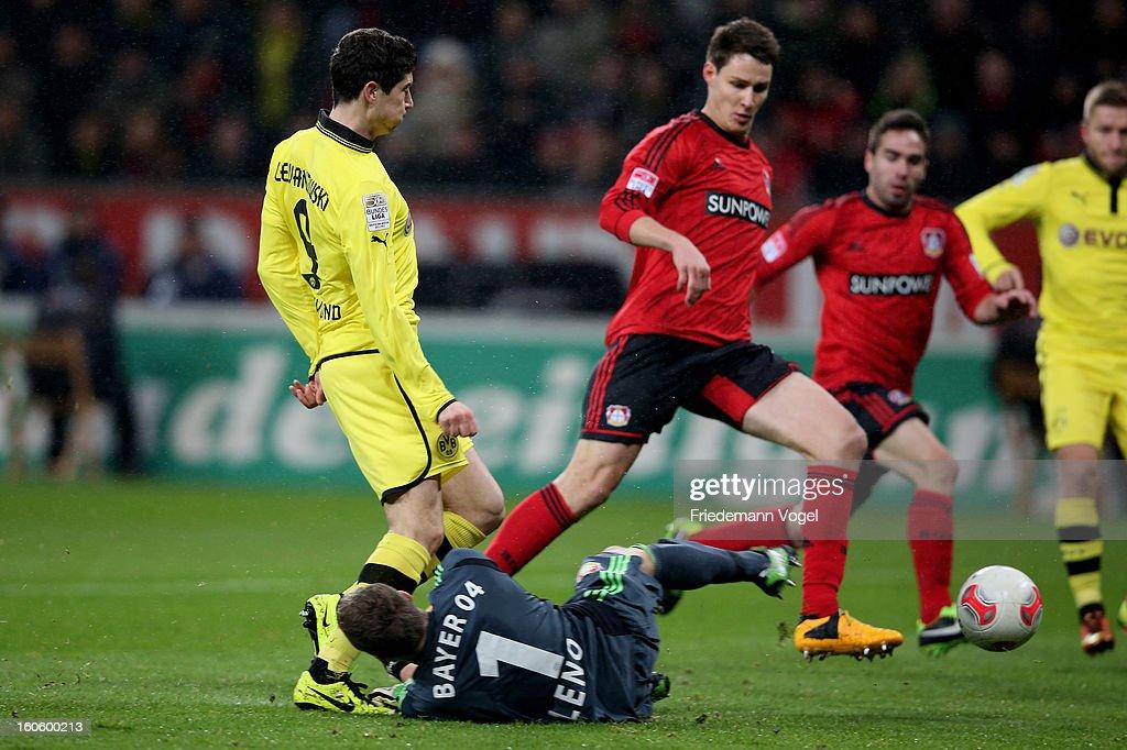 Bernd Leno (R) of Leverkusen and Robert Lewandowski (L) of Dortmund battle for the ball during the Bundesliga match between Bayer 04 Leverkusen and Borussia Dortmund at BayArena on February 3, 2013 in Leverkusen, Germany.