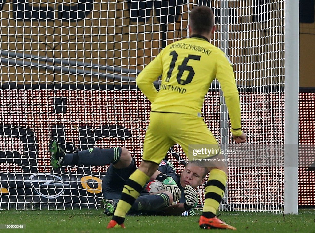 Bernd Leno (L) of Leverkusen saves a penalty from Jakub Kuba Blaszczykowski (16) of Dortmund battle for the ball during the Bundesliga match between Bayer 04 Leverkusen and Borussia Dortmund at BayArena on February 3, 2013 in Leverkusen, Germany.