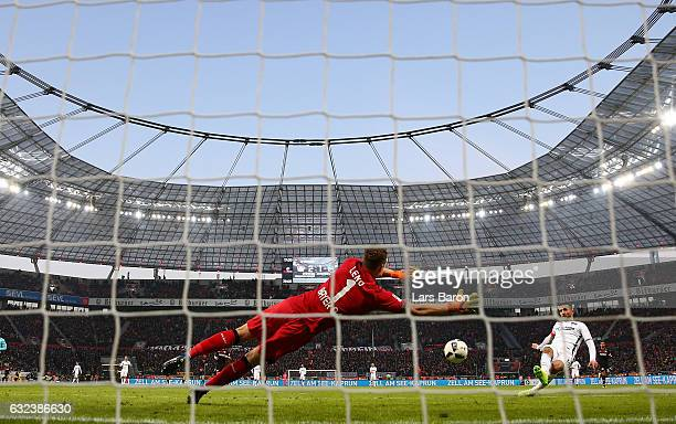 Bernd Leno of Leverkusen saves a shot from Vedad Ibisevic of Berlin during the Bundesliga match between Bayer 04 Leverkusen and Hertha BSC at...