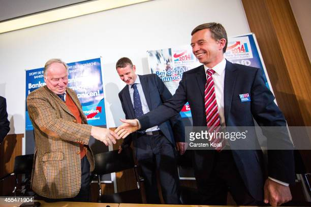 Bernd Lucke head of the Alternative fuer Deutschland political party smiles as he attends a press conference with colleague AfD Brandenburg lead...