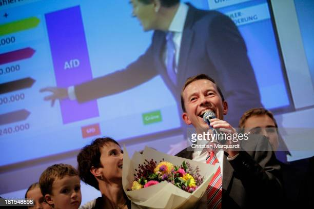 Bernd Lucke head of the Euroskeptic political party Alternative fuer Deutschland reacts to initial exit poll results that give the party 49% of the...