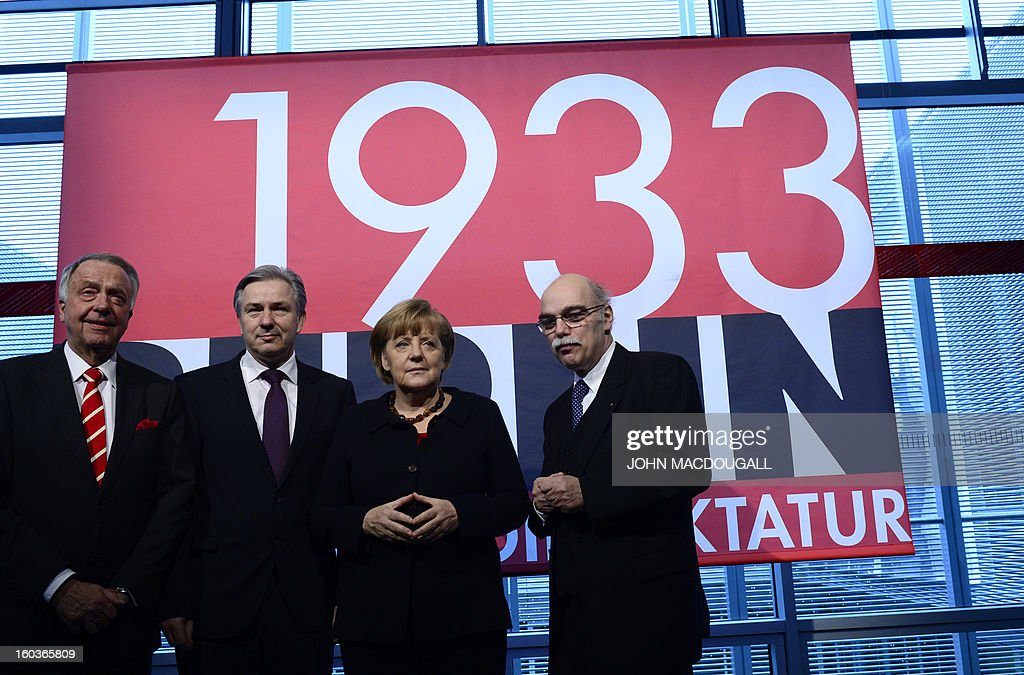 Bernd Naumann, Minister of State, Berlin's mayor Klaus Wowereit, German Chancellor Angela Merkel, Professor Andreas Nachama, managing director of 'Topographie des Terrors' inaugurate the exhibition 'Berlin 1933 On the Path to Dictatorship', tracing Adolf Hitler's rise to power in Germany in 1933 to mark 80 years since he became chancellor on January 30, 2013 at the open-air documentation center Topographie des Terrors in Berlin. The exhibition located at the former headquarters of the Gestapo, the secret police of the Nazi regime, traces Hitler's first months in power through photos, newspapers and posters.AFP PHOTO / JOHN MACDOUGALL