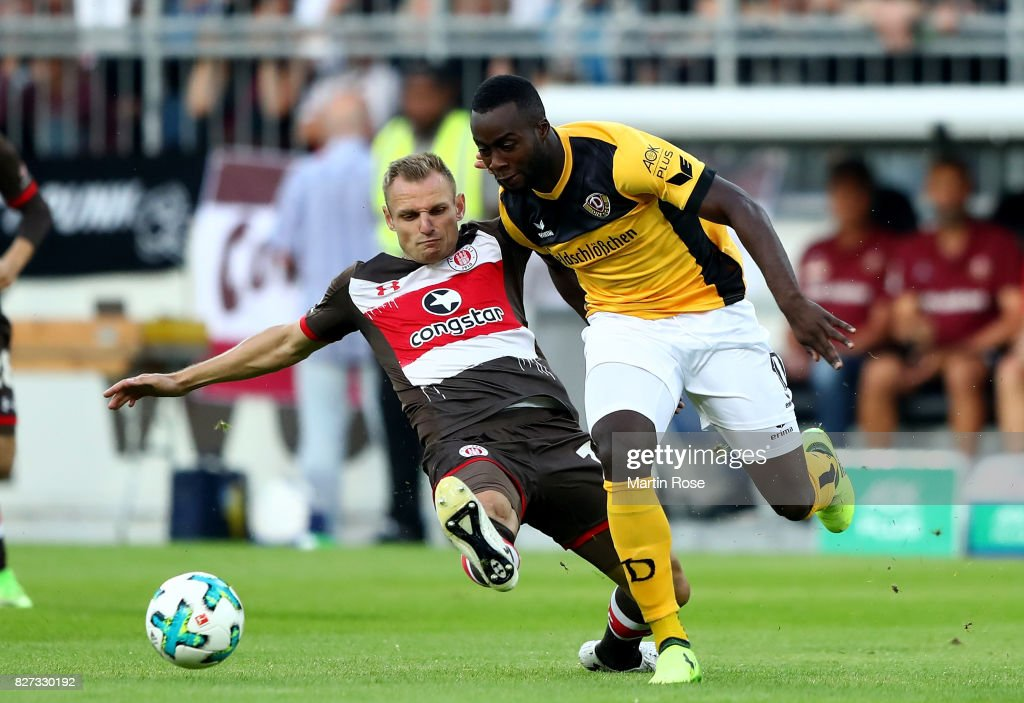 Bernd Nehrig (L) of St. Pauli and Erich Berko of Dresden battlle for the ball during the Second Bundesliga match between FC St. Pauli and SG Dynamo Dresden at Millerntor Stadium on August 7, 2017 in Hamburg, Germany.