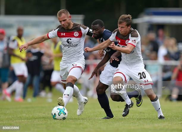 Bernd Nehrig of St Pauli and Tshomba Luvumbu Oliveira of Oldenburg and Richard Neudecker of St Pauli battle for the ball during the preseason...